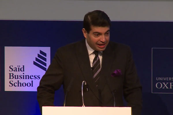 Dr. Atif Ansar speaking on a public debate at the Saïd Business School, University of Oxford