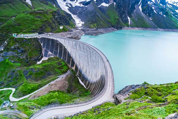 Large water dam surrounded by mountains