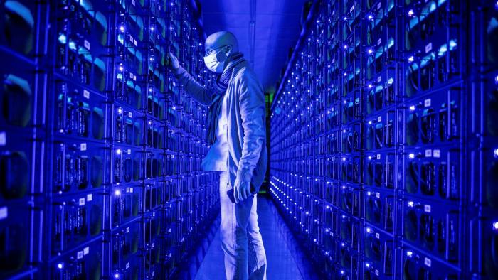 Bitcoin mining servers with a man in the dark